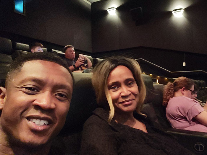 Caprice and his mother at the movies prior to the pandemic.